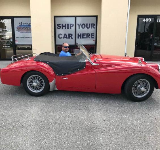 man riding a red car