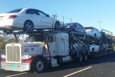 truck deliver different kinds of cars