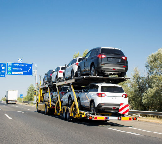 car carrier loaded with cars on the road
