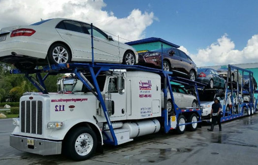 large truck carrying cars