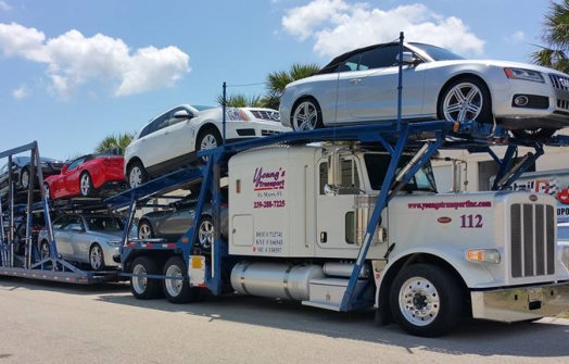 car carrier carrying cars on the road